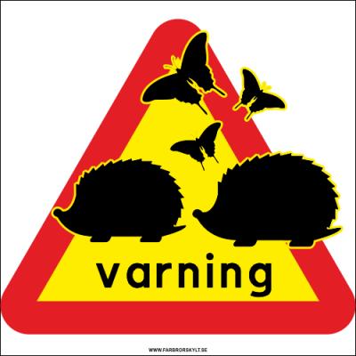 Varningsskylt för igelkottar där två igelkottar i svart passerar en varningstriangel.